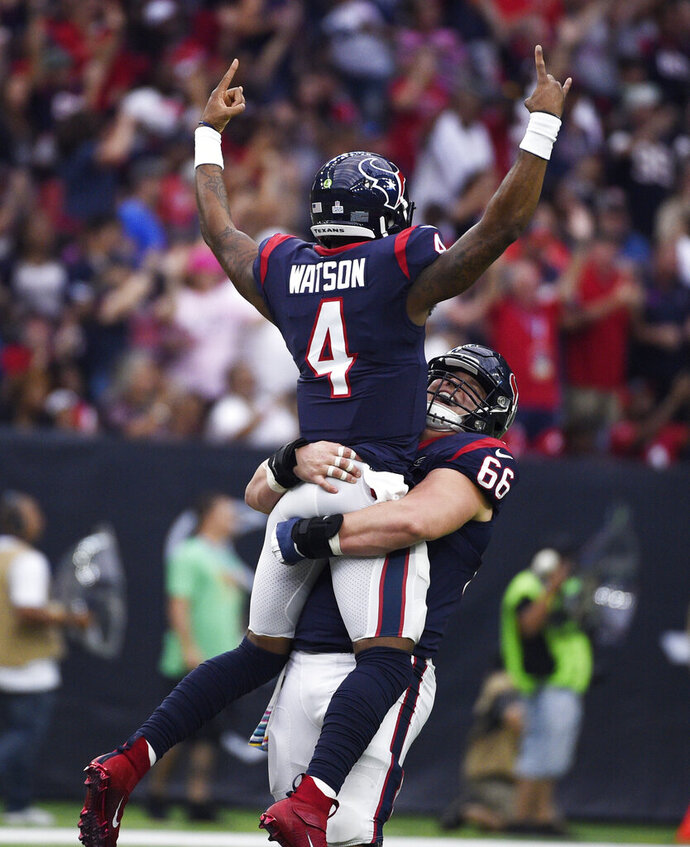 Houston Texans quarterback Deshaun Watson (4) is lifted by teammate Nick Martin (66) as they celebrate a touchdown against the Atlanta Falcons during the first half of an NFL football game Sunday, Oct. 6, 2019, in Houston. (AP Photo/Eric Christian Smith)