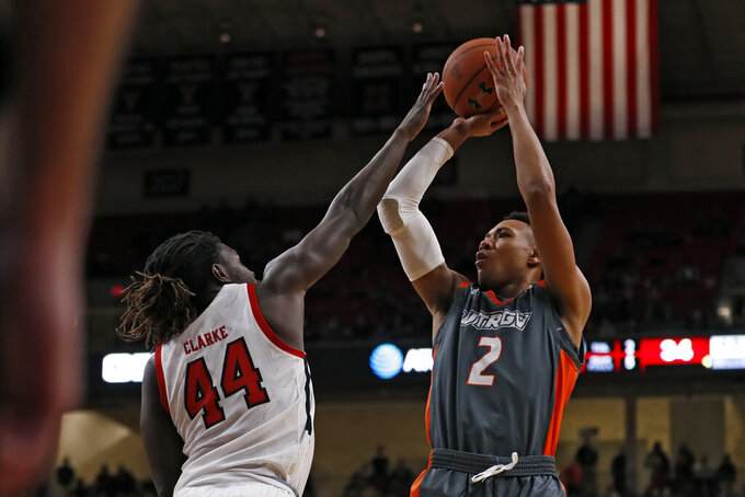 Texas-Rio Grande Valley's Quinton Johnson II (2) shoots the ball over Texas Tech's Chris Clarke (44) during the second half of an NCAA college basketball game Saturday, Dec. 21, 2019, in Lubbock, Texas. (AP Photo/Brad Tollefson)