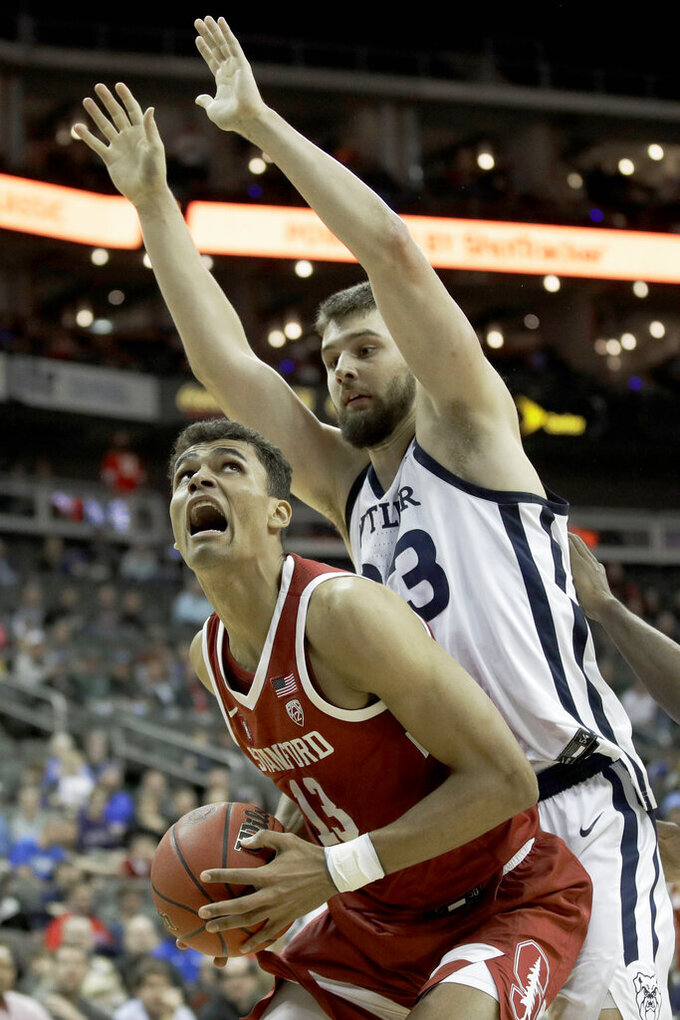 Stanford forward Oscar da Silva (13) looks to shoot under pressure from Butler forward Bryce Golden (33) during the first half of an NCAA college basketball game Tuesday, Nov. 26, 2019, in Kansas City, Mo. (AP Photo/Charlie Riedel)