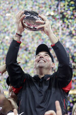 Ohio State coach Ryan Day holds the trophy following the Big Ten championship NCAA college football game against Wisconsin, early Sunday, Dec. 8, 2019, in Indianapolis. Ohio State won 34-21. (AP Photo/Michael Conroy)