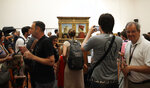 Visitors admire Italian Renaissance painter Piero Della Francesca's portraits of the Duke and Duchess of Urbino, Federico da Montefeltro and his wife Battista Sforza, at the Uffizi Gallery museum, in Florence, Italy, Tuesday, Aug. 6, 2019. With the paintings safely behind nearly invisible barriers, no annoying ropes need separate visitors from the paintings, and, to Uffizi Gallery director Eike Schmidt's delight, museum-goers press their noses right up against the climate-controlled display cases. (AP Photo/Luca Bruno)