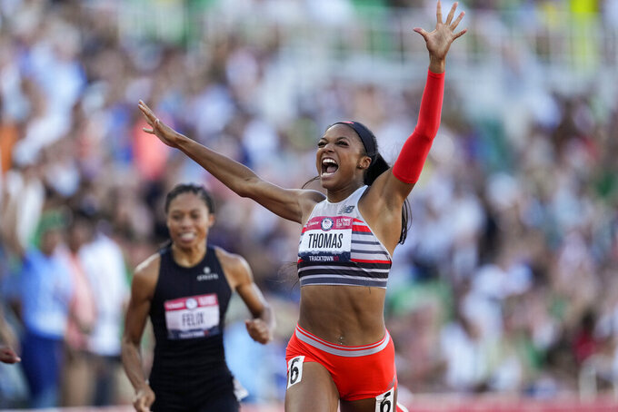 Gabby Thomas celebrates after winning the final in the women's 200-meter run at the U.S. Olympic Track and Field Trials Saturday, June 26, 2021, in Eugene, Ore. (AP Photo/Ashley Landis)