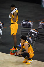 Oakland's Jalen Moore, right, and Micah Parrish watch as Cleveland State celebrates following an NCAA college basketball game in the men's Horizon League conference tournament championship game against Cleveland State, Tuesday, March 9, 2021, in Indianapolis. Cleveland State won 80-69 (AP Photo/Darron Cummings)