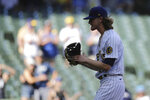 Milwaukee Brewers' Josh Hader claps after recording a save during the ninth inning of a baseball game against the Pittsburgh Pirates, Sunday, June 13, 2021, in Milwaukee. (AP Photo/Aaron Gash)