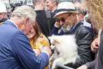 Britain's Prince Charles greets members of the public during a walk at Viaduct Harbour in Auckland during their royal visit to New Zealand, Tuesday, Nov. 19, 2019. The visit is part of a week-long tour of the country which also takes in Christchurch and Kaikoura. (David Rowland/Pool Photo via AP)