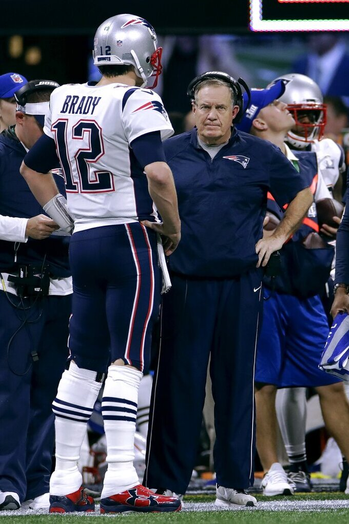 New England Patriots' Tom Brady, left, talks with head coach Bill Belichick during the first half of the NFL Super Bowl 53 football game against the Los Angeles Rams, Sunday, Feb. 3, 2019, in Atlanta. (AP Photo/Carolyn Kaster)