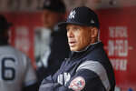 FILE - In this May 9, 2017 file photo, New York Yankees manager Joe Girardi, left, works in the dugout before the first inning of a baseball game against the Cincinnati Reds in Cincinnati. Person familiar with deal tells AP the Philadelphia Phillies are hiring Girardi as manager, Thursday, Oct. 24, 2019.   (AP Photo/John Minchillo, File)