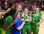 Oregon guard Sabrina Ionescu (20) is interviewed as her team surrounds her after a victory over Stanford in an NCAA college basketball game Sunday, Feb. 10, 2019, in Stanford, Calif. (AP Photo/Tony Avelar)