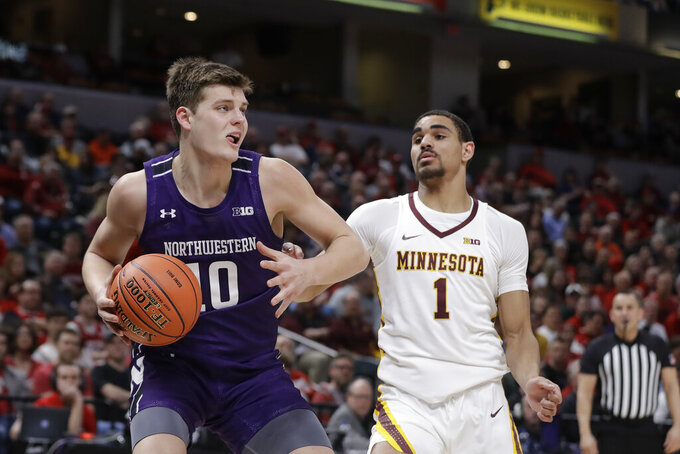 Northwestern's Miller Kopp (10) goes to the basket against Minnesota's Tre' Williams (1) during the second half of an NCAA college basketball game at the Big Ten Conference tournament, Wednesday, March 11, 2020, in Indianapolis. Minnesota won 74-57. (AP Photo/Darron Cummings)