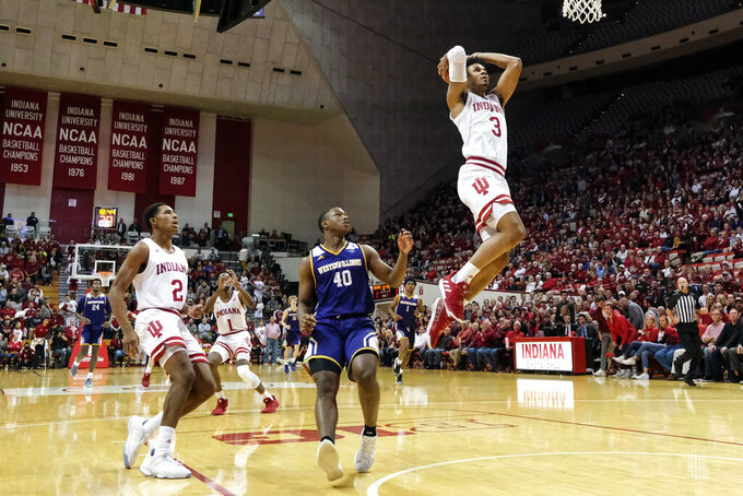 Indiana forward Justin Smith (3) goes up for a dunk in front of Western Illinois guard C.J. Duff (40) in the first half of an NCAA college basketball game in Bloomington, Ind., Tuesday, Nov. 5, 2019. (AP Photo/AJ Mast)