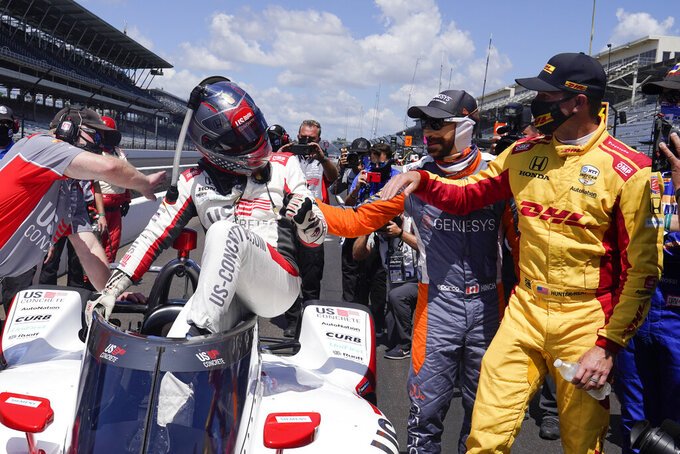 Marco Andretti is congratulated James Hinchcliffe, of Canada, and Ryan Hunter-Reay after Andretti won the pole for the Indianapolis 500 auto race at Indianapolis Motor Speedway, Sunday, Aug. 16, 2020, in Indianapolis. (AP Photo/Darron Cummings)