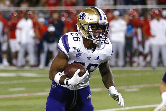 Washington running back Salvon Ahmed runs for a touchdown against Washington in the second half during an NCAA college football game, Saturday, Oct. 12, 2019, in Tucson, Ariz. (AP Photo/Rick Scuteri)