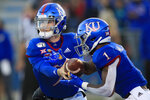 Kansas quarterback Carter Stanley, left, hands off to running back Pooka Williams Jr. (1) during the first half of an NCAA college football game against Texas Tech in Lawrence, Kan., Saturday, Oct. 26, 2019. (AP Photo/Orlin Wagner)