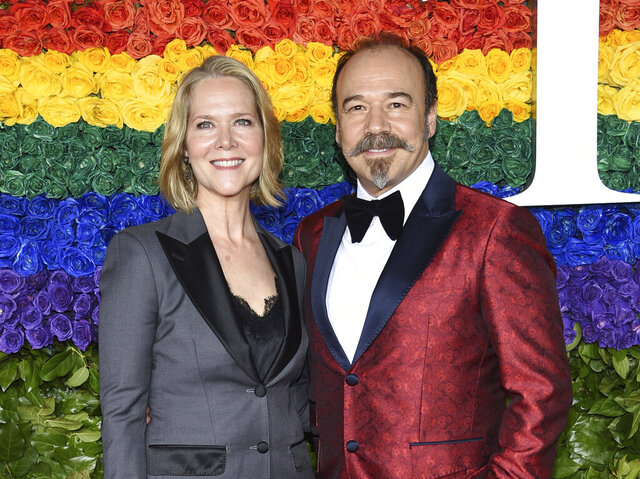FILE - Rebecca Luker, left, and her husband Danny Burstein arrive at the 73rd annual Tony Awards in New York on June 9, 2019. Luker, 59, a three-time Tony nominated actor who starred in some of the biggest Broadway hits of the past three decades, died Wednesday, Dec. 23, 2020, said Sarah Fargo, her agent. The actor went public in 2020 saying he had been diagnosed with amyotrophic lateral sclerosis, known as A.L.S. or Lou Gehrig's disease. (Photo by Evan Agostini/Invision/AP, File)