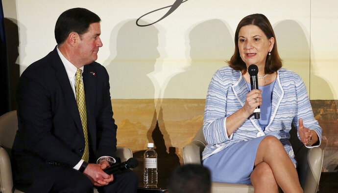 Ambassador of Mexico to the U. S., Martha Barcena, right, answers a question at the 2019 Arizona-Mexico Commission Governor's Luncheon, as Arizona Gov. Doug Ducey, left, listens Tuesday, March 19, 2019, in Phoenix. (AP Photo/Ross D. Franklin)