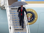 President Donald Trump walks down the steps of Air Force One at Los Angeles International Airport Tuesday, March 13, 2018. (AP Photo/Reed Saxon)