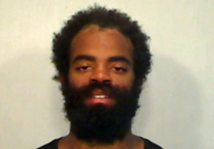 This photo provided by Monroe County Sheriff's Office shows Andrew Toles.   A sheriff deputy arrested Toles at the airport in Key West on Monday, June 22, 2020. The Miami Herald reported that Toles was found sleeping behind a Federal Express building at the airport and refused to move. Toles, who plays for the Los Angeles Dodgers, is facing a misdemeanor charge of trespassing on a property.  (Monroe County Sheriff's Office via AP)