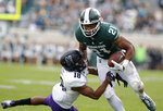 FILE - In this Saturday, Oct. 6, 2018, file photo, Northwestern's Cameron Ruiz (18) defends Michigan State's Cam Chambers (21) during the fourth quarter of an NCAA college football game, in East Lansing, Mich. Ruiz is ready to take a leadership role in 2019. He got a good amount of experience because of injuries in the secondary and made 26 tackles, broke up four passes, forced a fumble and recovered one. (AP Photo/Al Goldis, File)