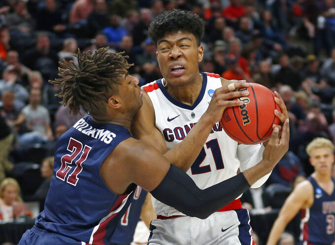 Fairleigh Dickinson forward Elyjah Williams, left, defends against Gonzaga forward Rui Hachimura during the second half of a first-round game in the NCAA men's college basketball tournament Thursday, March 21, 2019, in Salt Lake City. (AP Photo/Rick Bowmer)