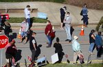 Voters wait in line outside the Herbert C. Young Community Center in Cary, N.C. on the first day of early voting Thursday, Oct. 15, 2020. (Ethan Hyman/The News & Observer via AP)