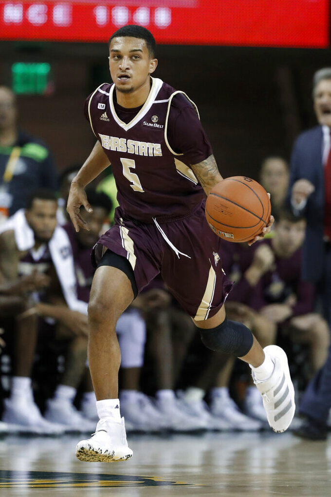 Texas State guard Marlin Davis brings the ball up during the first half of the team's NCAA college basketball game against Baylor in Waco, Texas, Friday, Nov. 15, 2019. (AP Photo/Tony Gutierrez)