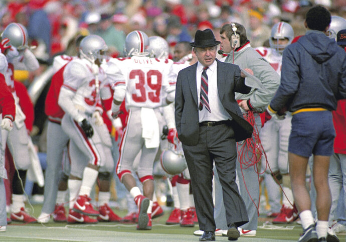 FILE - In this Nov. 21, 1987, file photo, Ohio State head coach Earle Bruce gestures on the sidelines during a game against Michigan in Ann Arbor, Mich. Bruce died in Columbus, Ohio at the age of 87, according to a statement released by his daughters through Ohio State on Friday. He'd been suffering from Alzheimer's disease.   (AP Photo/Robert Kozloff, File)