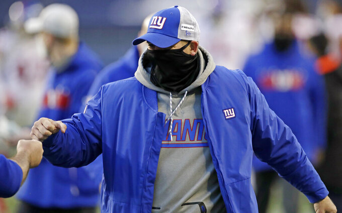 New York Giants head coach Joe Judge is greeted after an NFL football game against the Seattle Seahawks, Sunday, Dec. 6, 2020, in Seattle. The Giants won 17-12. (AP Photo/Larry Maurer)