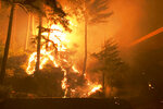 This photo was taken by Don Myron as he shielded himself with a green plastic chair from a deadly wildfire while sheltering from the flames on a rock in the middle of Little North Santiam River after fleeing his home in Lyons, Ore., Monday, Sept. 7, 2020. Note the chairs in the foreground.