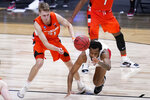 Syracuse forward Marek Dolezaj (21) and Houston forward Justin Gorham (4) battle for a loose ball in the second half of a Sweet 16 game in the NCAA men's college basketball tournament at Hinkle Fieldhouse in Indianapolis, Saturday, March 27, 2021. (AP Photo/Michael Conroy)