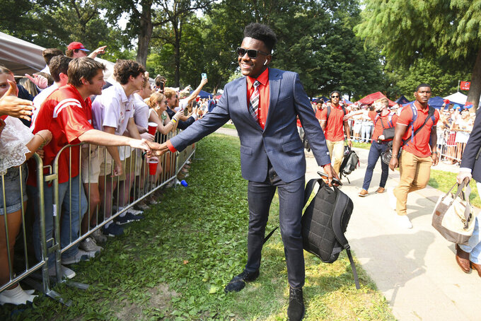 Mississippi defensive back MJ Daniels (16) shakes hands with fans as the team walks through the Grove before an NCAA college football game against Austin Peay in Oxford, Miss., Saturday, Sept. 11, 2021. (AP Photo/Bruce Newman)
