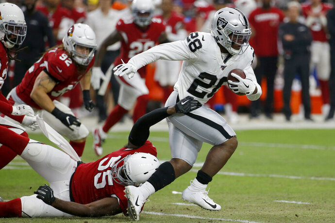 FILE - In this Aug. 15, 2019, file photo, Oakland Raiders running back Josh Jacobs (28) runs against the Arizona Cardinals during the first half of an an NFL football game in Glendale, Ariz. Once the regular season starts, the Raiders are hoping Jacobs can be the three-down featured back that has been missing of late on Oakland's offense. (AP Photo/Rick Scuteri, File)