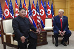 FILE - In this June 30, 2019, file photo President Donald Trump, right, listens as North Korean leader Kim Jong Un, left, speaks during their bilateral meeting inside the Freedom House at the border village of Panmunjom in the Demilitarized Zone, South Korea. Trump is still waiting for his two years of one-on-one diplomacy with Kim Jong Un to pay off with a deal that eliminates the threat of North Korea's nuclear weapons. (AP Photo/Susan Walsh, File)