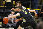 Oregon guard Payton Pritchard, front, steals a pass intended for Colorado forward Lucas Siewert in the first half of an NCAA college basketball game Saturday, Feb. 2, 2019, in Boulder, Colo. (AP Photo/David Zalubowski)