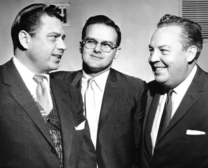 FILE -- This Jan. 26, 1960, file photo shows American Football League president Lamar Hunt, center, flanked by Bud Adams, left, owner of the Houston AFL team, and Harry Wismer, owner of the New York AFL team, in Dallas.  Lamar Hunt was a champion of Black rights during the Civil Rights era of the 1960s. He grew up in conservative circles yet formed his own opinions of right and wrong. (AP Photo/File)