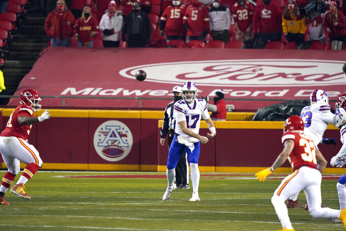Buffalo Bills quarterback Josh Allen throws a pass during the first half of the AFC championship NFL football game against the Kansas City Chiefs, Sunday, Jan. 24, 2021, in Kansas City, Mo. (AP Photo/Jeff Roberson)