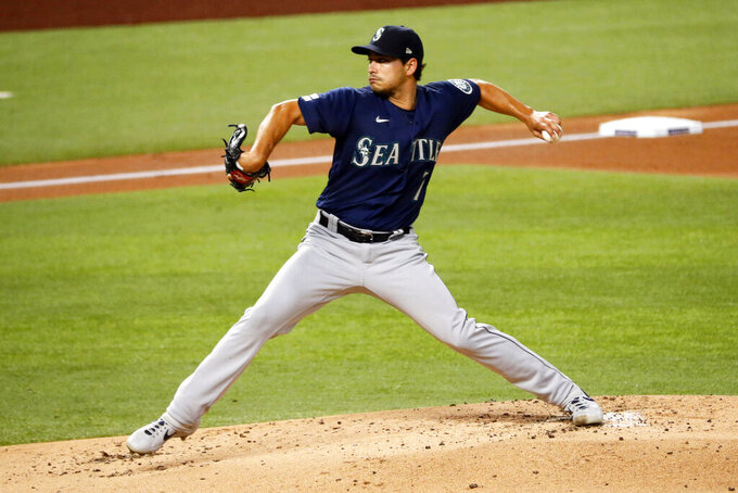 Seattle Mariners starting pitcher Marco Gonzales delivers to the Texas Rangers in the first inning of a baseball game in Arlington, Texas, Tuesday, Aug. 11, 2020. (AP Photo/Ray Carlin)