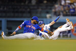 Los Angeles Dodgers' Trea Turner, right, is caught stealing second base by New York Mets shortstop Jonathan Villar (1) during the third inning of a baseball game Thursday, Aug 19, 2021, in Los Angeles. (AP Photo/Ashley Landis)