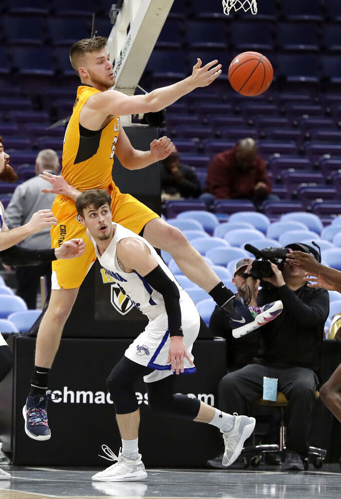 Valparaiso's Derrik Smits, top, knocks the ball away as Indiana State's Cooper Neese watches during the first half of an NCAA college basketball game in the first round of the Missouri Valley Conference men's tournament Thursday, March 7, 2019, in St. Louis. (AP Photo/Jeff Roberson)