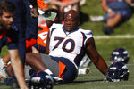 FILE - In this July 19, 2019, file photo, Denver Broncos offensive tackle Ja'Wuan James (70) stretches during NFL football training camp in Englewood, Colo. More than half of the 67 NFL players who opted out of the 2020 season amid the COVID-19 pandemic are no longer with the same team and almost two dozen aren't on anyone's roster. Among last year's opt outs who have landed with other teams is right tackle Ja'Wuan James, who signed with the Ravens after his unceremonious departure from Denver. (AP Photo/David Zalubowski, File)