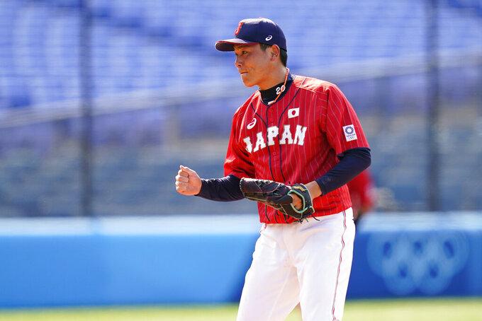 Japan's Ryoji Kuribayashi reacts after Japan won a baseball game against Mexico at Yokohama Baseball Stadium during the 2020 Summer Olympics, Saturday, July 31, 2021, in Yokohama, Japan. (AP Photo/Matt Slocum)