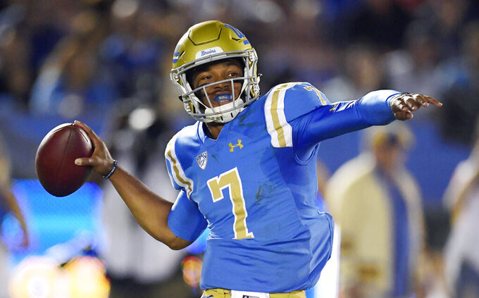 FILE - In this Oct. 20, 2018, file photo, UCLA quarterback Dorian Thompson-Robinson passes during the first half of an NCAA college football game against Arizonain Pasadena, Calif. The offense returns nine starters, including sophomore quarterback Dorian Thompson-Robinson and senior running back Joshua Kelley, who went for 289 yards in the victory over USC. (AP Photo/Mark J. Terrill, File)