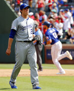 Kansas City Royals' Homer Bailey (21) waits for another ball after giving up a two-run home run to Texas Rangers' Joey Gallo, rear, in the fourth inning of a baseball game in Arlington, Texas, Saturday, June 1, 2019. (AP Photo/Tony Gutierrez)