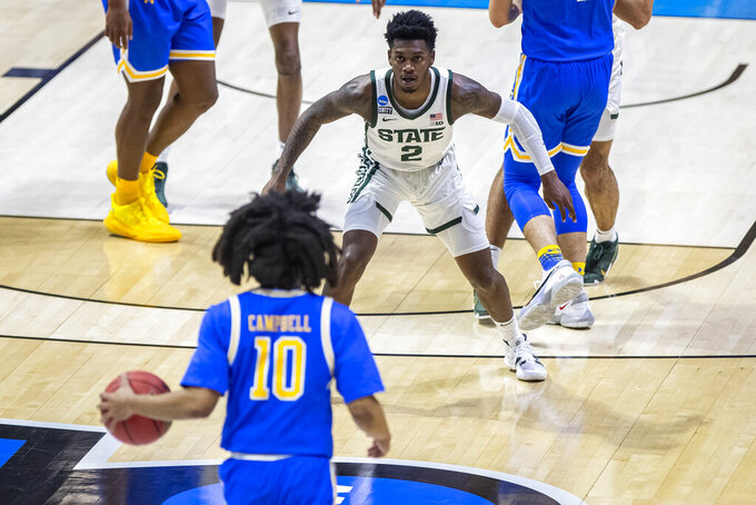 Michigan State's Rocket Watts (2) sets up on defense as UCLA's Tyger Campbell (10) brings the ball up during the first half of a First Four game in the NCAA men's college basketball tournament Thursday, March 18, 2021, at Mackey Arena in West Lafayette, Ind. (AP Photo/Robert Franklin)