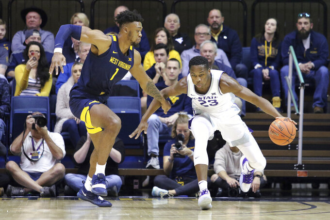 Kansas State forward Montavious Murphy (23) drives it up court as he is defended by West Virginia forward Derek Culver (1) during the first half of an NCAA college basketball game Saturday, Feb. 1, 2020, in Morgantown, W.Va. (AP Photo/Kathleen Batten)