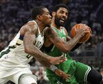 Boston Celtics' Kyrie Irving tries to drive past Milwaukee Bucks' Eric Bledsoe during the second half of Game 2 of a second round NBA basketball playoff series Tuesday, April 30, 2019, in Milwaukee. The Bucks won 123-102 to tie the series at 1-1. (AP Photo/Morry Gash)