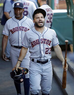 Houston Astros' Jose Altuve (27) shouts in the dugout before the team's baseball game against the Los Angeles Angels on Tuesday, July 16, 2019, in Anaheim, Calif. (AP Photo/Marcio Jose Sanchez)