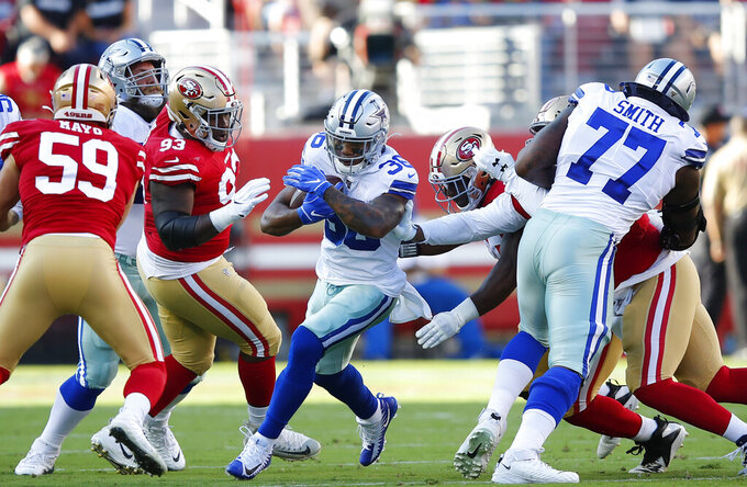 Dallas Cowboys running back Tony Pollard, center, carries against the San Francisco 49ers during the first half of an NFL preseason football game in Santa Clara, Calif., Saturday, Aug. 10, 2019. (AP Photo/John Hefti)