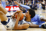 Villanova's Jeremiah Robinson-Earl, front, calls for a timeout after recovering a loose ball next to Marquette's Symir Torrence during the second half of an NCAA college basketball game Wednesday, Feb. 12, 2020, in Villanova, Pa. (AP Photo/Matt Slocum)