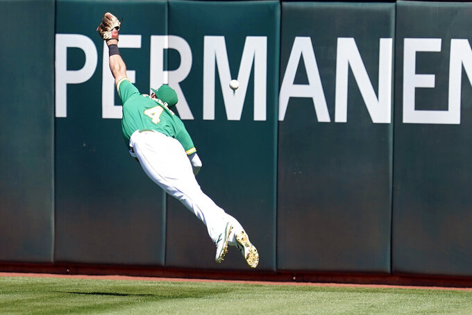 Oakland Athletics right fielder Chad Pinder cannot catch an RBI-triple by Texas Rangers' Leody Taveras during the fourth inning of a baseball game in Oakland, Calif., Sunday, Sept. 12, 2021. (AP Photo/Jeff Chiu)