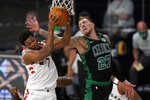 Toronto Raptors' Kyle Lowry (7) grabs a rebound in front of Boston Celtics' Daniel Theis (27) in the second half of an NBA conference semifinal playoff basketball game, Tuesday, Sept. 1, 2020, in Lake Buena Vista, Fla. (AP Photo/Mark J. Terrill)